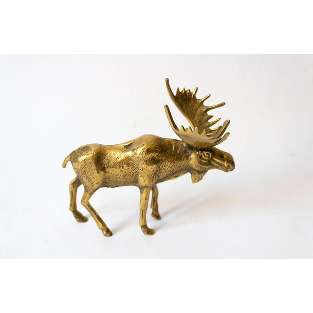 Charming brass moose figure in warm solid brass. Such a great styling piece!
