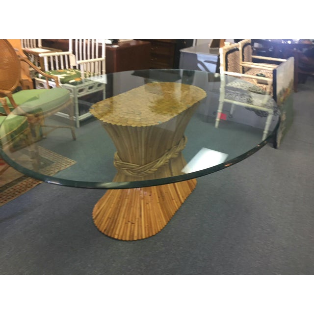 Stylish and attractive vintage McGuire table. Warm bamboo base and glass top.