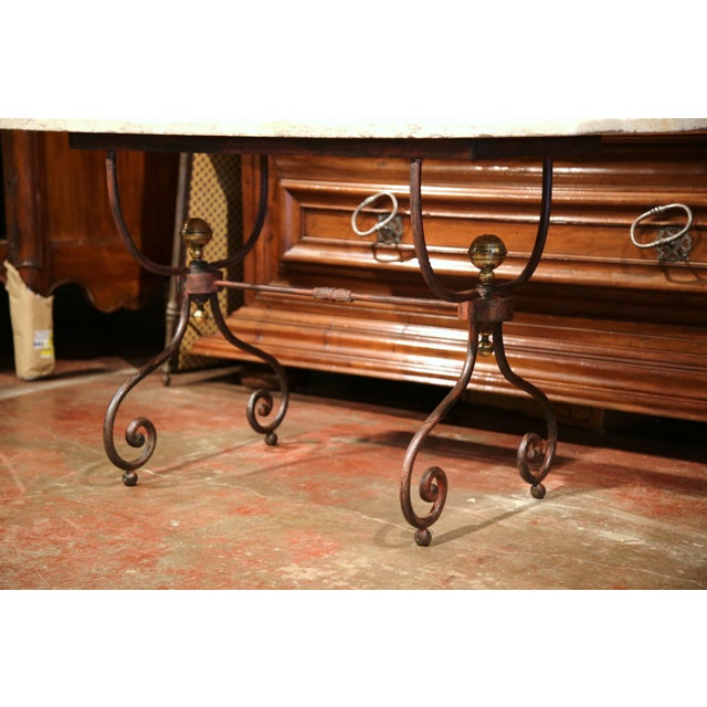 This elegant, antique bistrot table was forged in Paris, France circa 1880. The versatile table could be placed outside or...