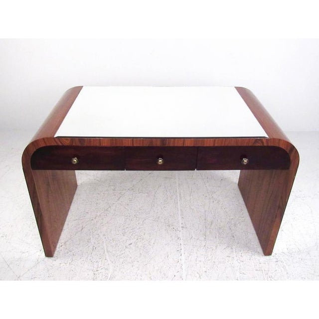 This contemporary modern rosewood writing table features bevelled mirror panels on the top and sides. Three drawers for...