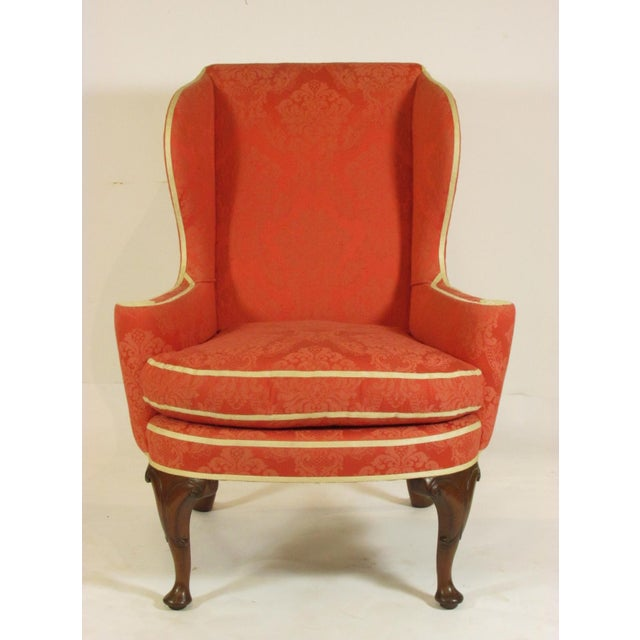A pair of late 19th-C. English George II walnut wing chairs with custom upholstery and down cushions, and hand carved...