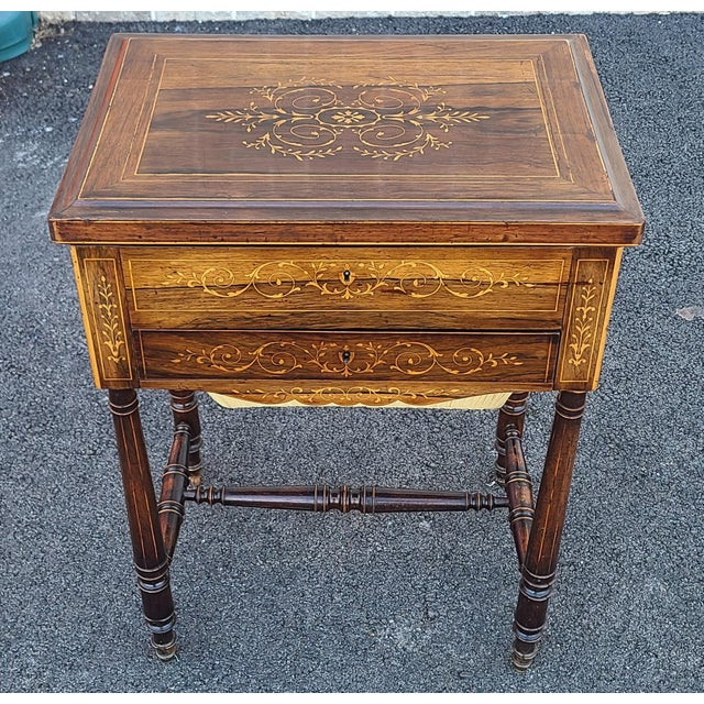 Antique English Regency style flip top sewing work table, c1890. Inlaid rosewood case with maple flip top opening to a...