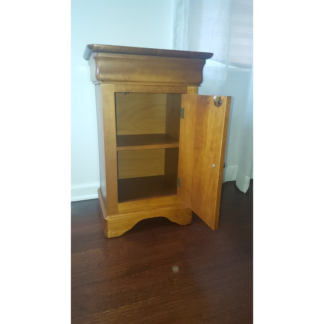 Pair of side tables in a light maple finish. Both are in excellent condition. Tables match with available Queen Sleigh bed...