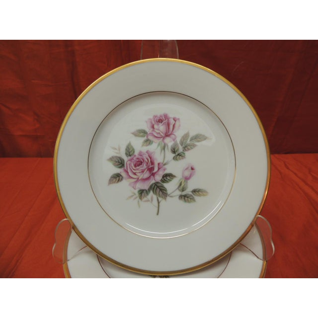 "Set of six (6) pink roses porcelain dessert plates with gold details. Size: 7.5"" D x.75"" H."