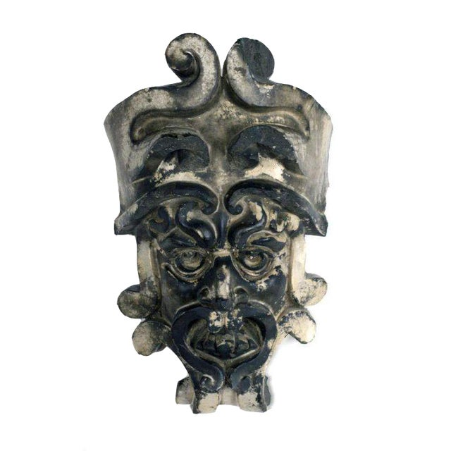 An elaborately sculpted terra cotta stone building fragment mask with a wonderful patina. English, 19th Century.