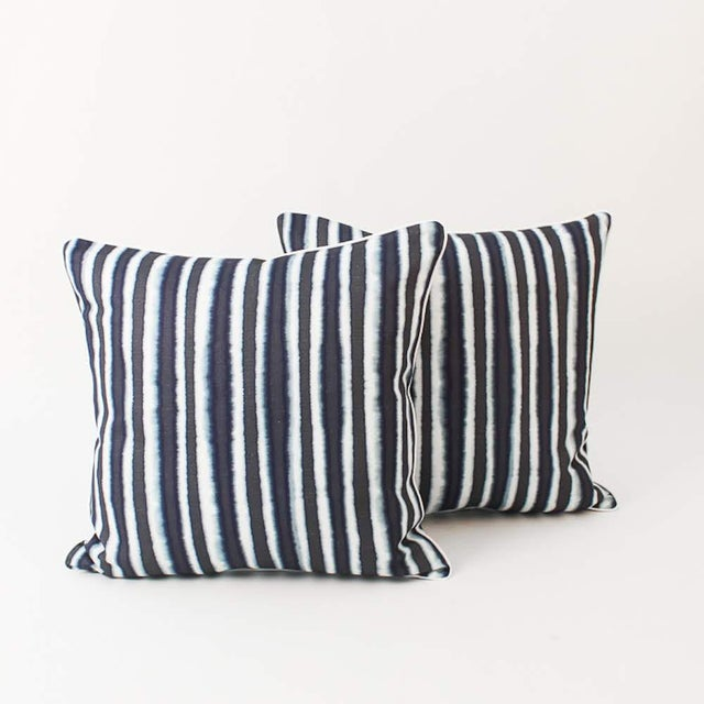 Pair of custom blue-and-ivory ombré striped pillows. Patterns on fronts with solid coordinating ivory linen backs and...
