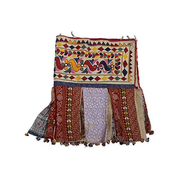 Antique, hand-embroidered, cotton fringed tent valance from India. Features flowers and mirrors.