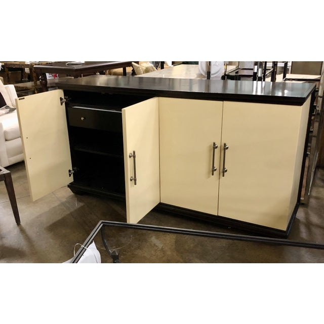 Adjustable shelving in a buffet or cabinet lets you create a compartment that suits your needs. Store large items like...