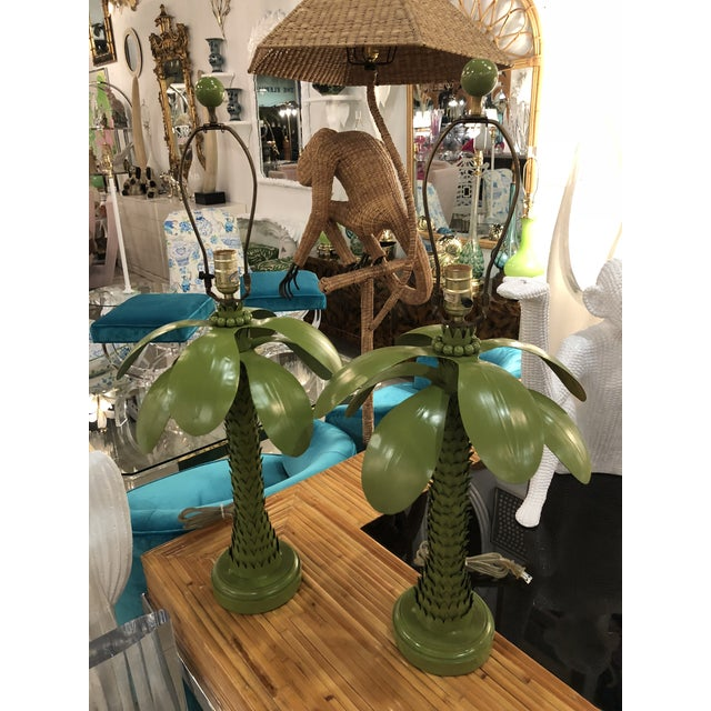 Lovely pair of vintage metal tole palm tree leaf table lamps includes matching finial. These lamps will be rewired prior...