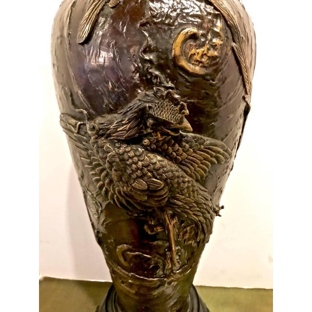 This is an outstanding example of a large Japanese Meiji period bronze vase now mounted as a lamp. The vase is cast with...