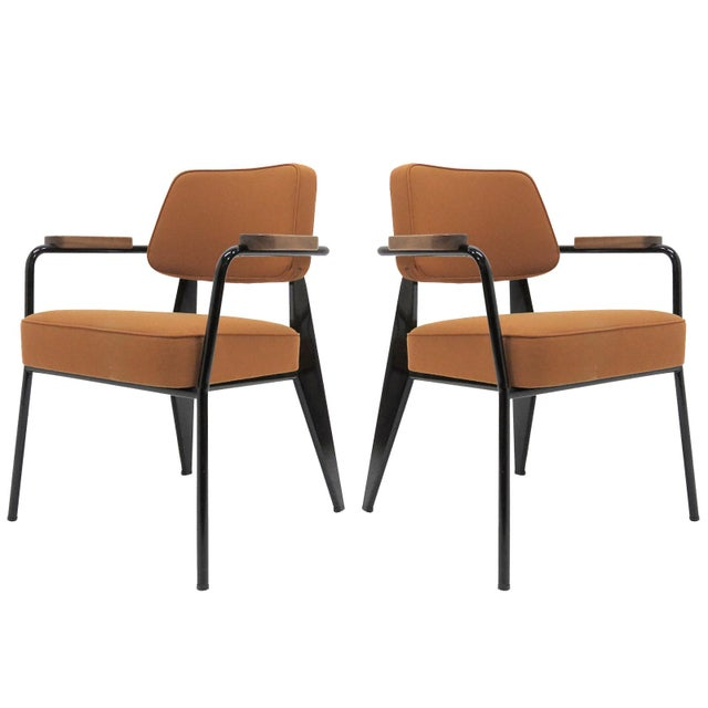 Wonderful compact armchairs Fauteuil Direction designed in 1951 by Jean Prouvé, produced by Vitra, in cognac colored twill...