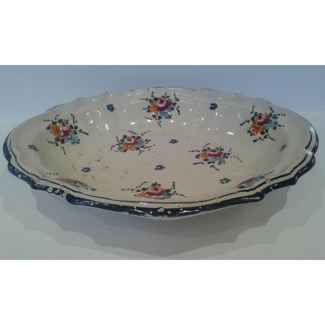 A big bowlful of rustic Italian farmhouse charm: pale yellow/cream background hand-painted with a double blue border...