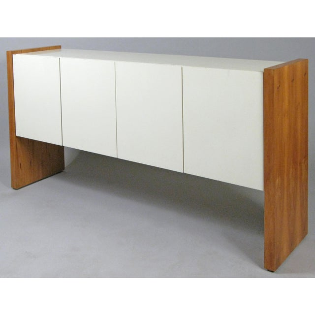 A very handsome and iconic 1960s cabinet designed by Milo Baughman for Thayer Coggin. designed with an ivory lacquered...