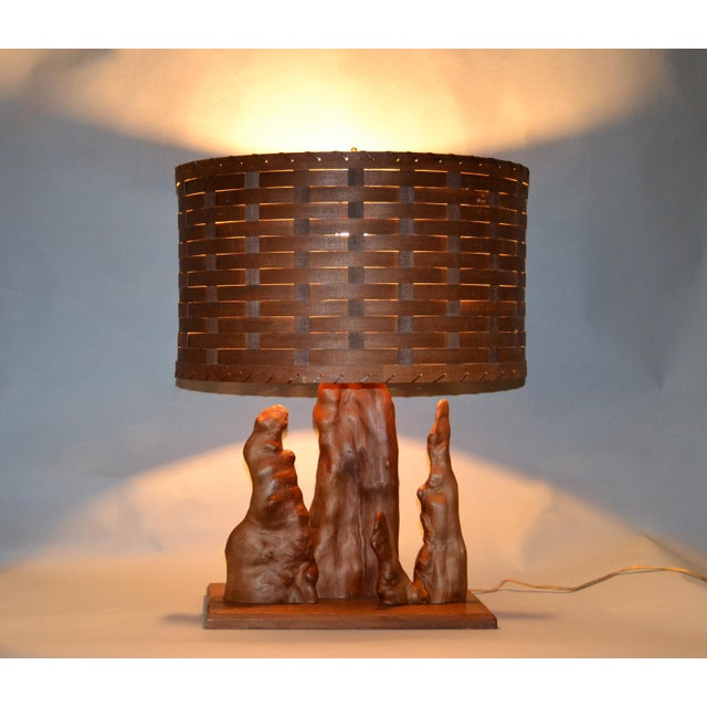 Organic Modern Sculptural Driftwood Table Lamp with handwoven Basket Shade mounted on a Walnut Base. In perfect working...