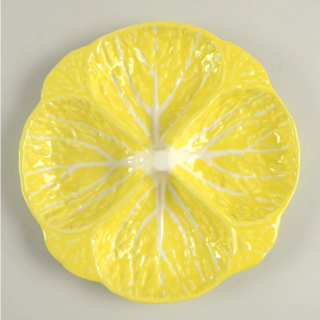 Secla Cabbage Yellow 4 Part Relish Dish features a bright yellow cabbage leaf shape. There are a few glaze flaw spots on...