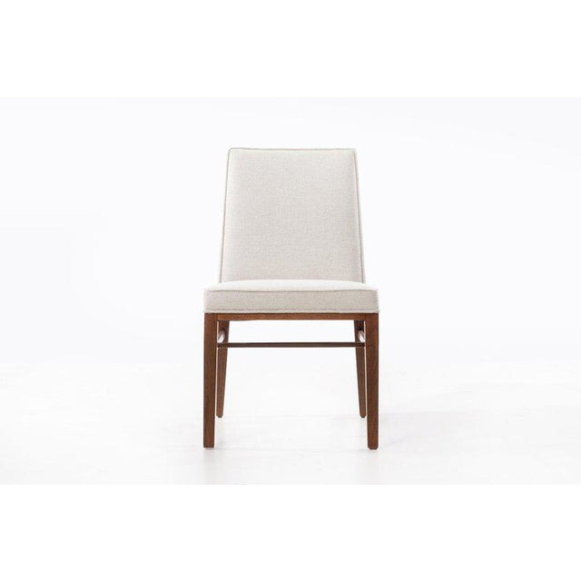 Edward Wormley (1907 - 1995) Set of six upholstered dining chairs raised on clear lacquered mahogany frames, with central...
