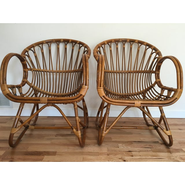 This pair of mid-century modern bamboo scoop chairs in the style of Franco Albini, circa 1960s, is in exceptional...