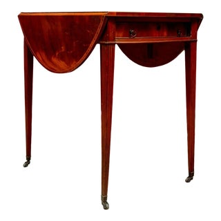 Flame Mahogany Oval Pembroke Table With Banded Inlay on Casters For Sale
