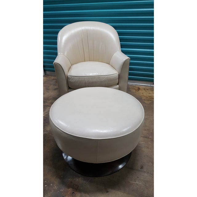Estate sale found, this wonderful cream leather swivel club chair and round ottoman have a wonderful modern shape and...