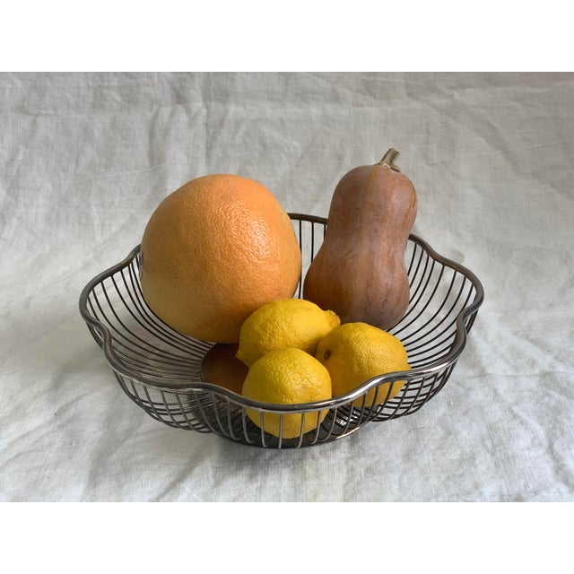 Charming and classic bowl for fruit or bread. Top of bowl is sterling; rest is likely polished steel. Light oxidation...