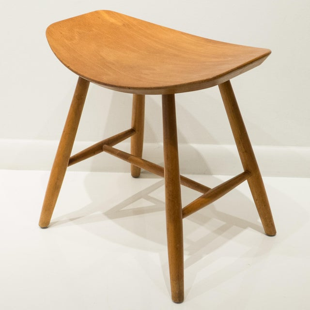 Stool with molded birch plywood seat and birch legs and stretchers. Designed by Ejvind Johansson and produced by FDB...