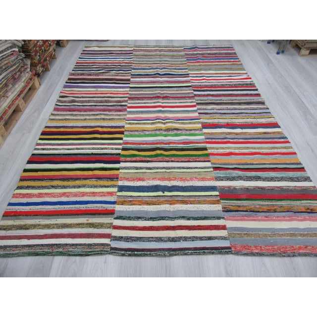 This is a vintage colorful striped rag rug from the adana region of turkey. The piece is approximately 50-60 years old.