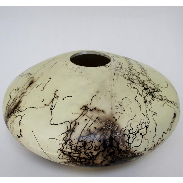 Navajo artisan horsehair vase in cream matte glaze with dark brown accents left by hair burning during firing process....