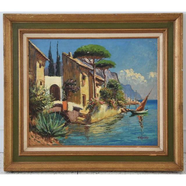 """Mediterranean lake with boats and village oil painting on canvas. Signed by the artist lower right corner """"A. Ravello."""" ...."""