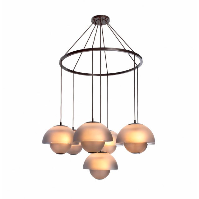 The Gilles Chandelier is hand made-to-order in the USA using ash finished opaque Murano Glass by Seguso. The Gilles is...