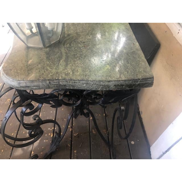 This is a very nice Circa 1900. French antique marble top console table , above a frieze with connecting C-links, over a...