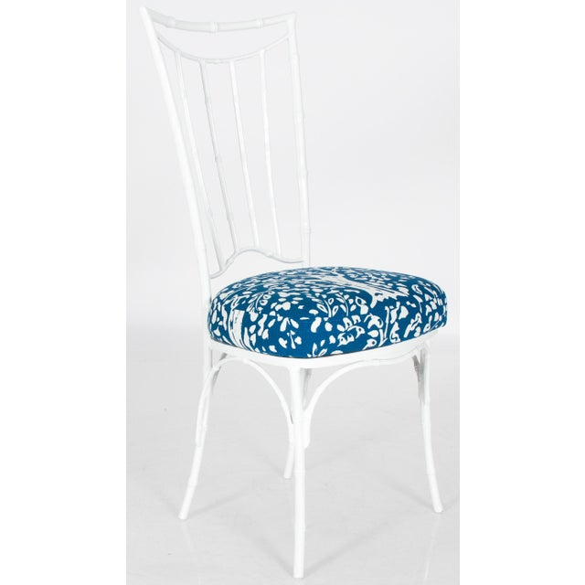 White metal faux bamboo dining set. Suitable for indoor or outdoor use. Square table with new clear glass top. Chairs and...