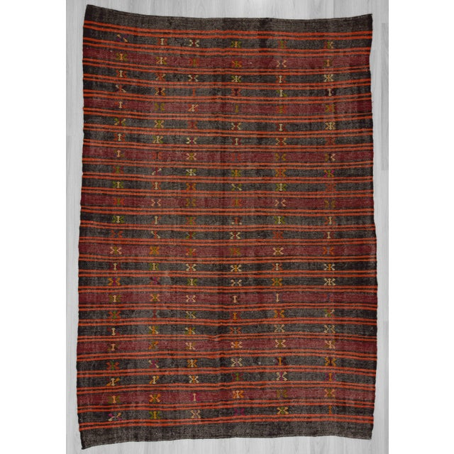 Handwoven black, orange, and burgundy large embroidered Turkish kilim rug. In very good condition.