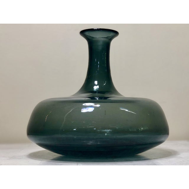 """Wayne Hasted for Blenko #565 charcoal decanter, no stopper. The color is a deep smokey blue and measure 8"""" tall, 8.5"""" at..."""