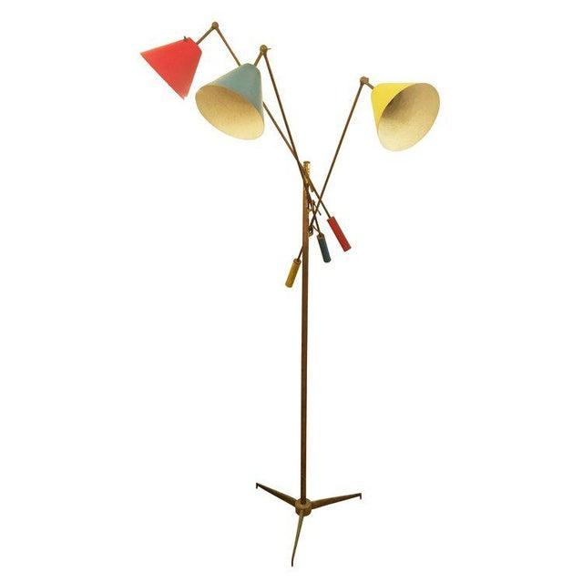Timeless adjustable brass floor lamp designed by Angelo Lelli for Arredoluce in 1947. The piece is marked and has been...