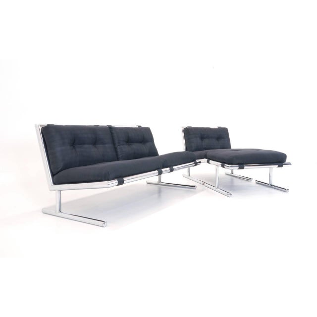 Functionally versatile, very comfortable loveseat (settee), chair and ottoman which we think may be designed by Milo...