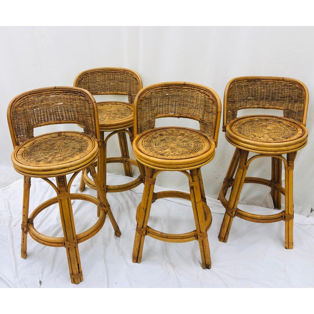 Fabulous Vintage Bent Bamboo Back and Woven Wicker Stools. Complete set of four with original hand made jute / woven sea...