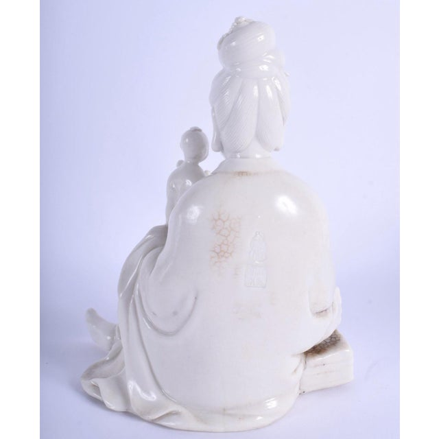 "A fine 18th/19th century Chinese Blanc de Chine figure of Guanyin Qing, bearing seal mark to reverse. 22 cm x 14 cm. 8.6""..."