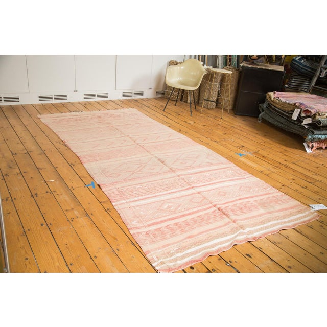 Super sweet pink rug featuring horizontal stripes and tribal fill designs throughout. Such nice handmade character and...