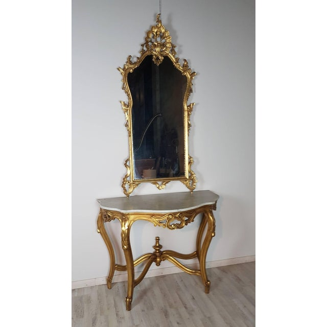 Very important beautiful rich and unobtainable console table with mirror richly carved in perfect style Italian Baroque....
