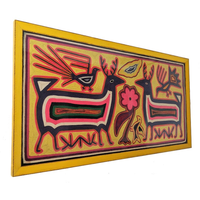 """Large, 50"""" across, framed Mola textile art. Bold and beautiful colors and design. We also have another 50"""" framed Mola..."""