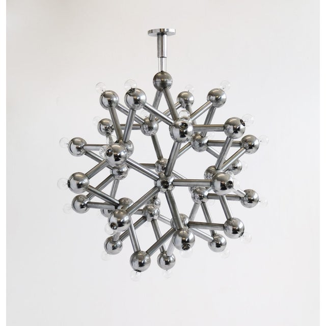 Chandelier by Kalmar, intersecting rods joined to form sculptural sphere.