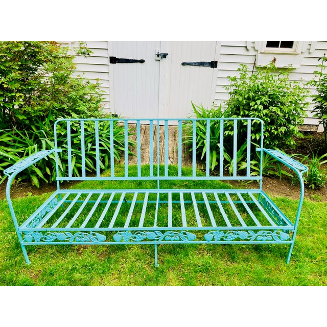 Whimsical, heavy wrought iron sofa from mid century or a bit earlier. The maker is a mystery although it is the quality...