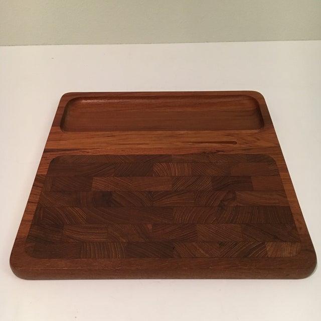 A vintage danish modern teak wood butcher block cheese tray. Made in Denmark.