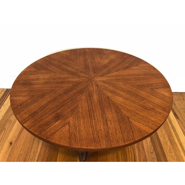 Absolutely beautiful Danish designed round teak coffee table with triangular woven base. Designed by Soren Georg Jensen...