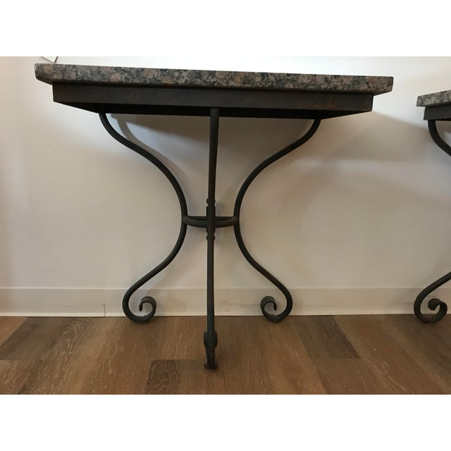 A pair of granite topped console table. Each table comes in two pieces for ease in moving. Sturdy iron base makes for a...