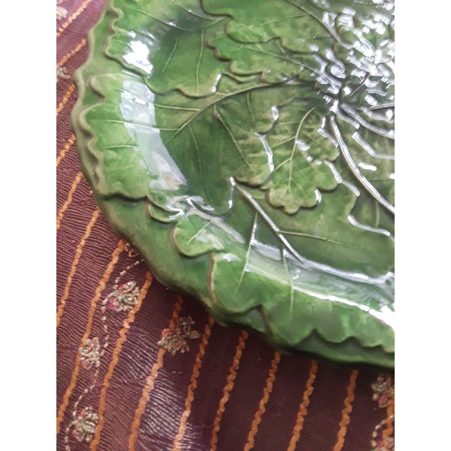 Vintage hand painted plate made in Italy. This mint condition plate features scalloped edges and raised veins like a...
