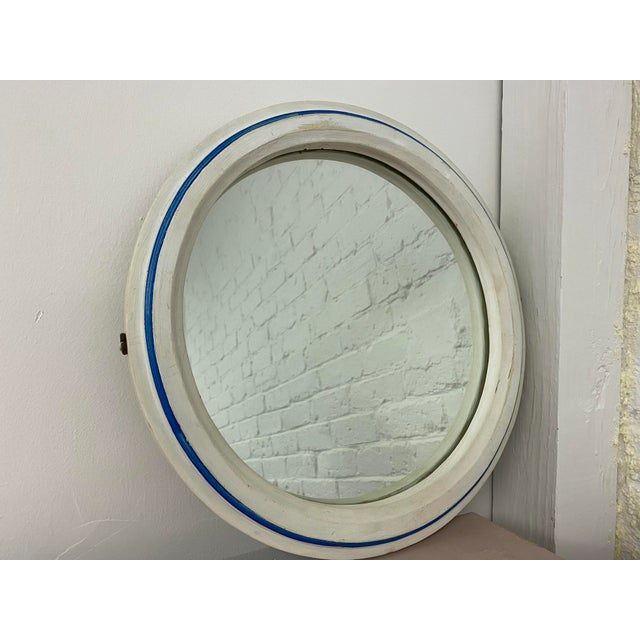This vintage painted nautical porthole mirror is the perfect addition to your beach inspired home. Use it in the kids...