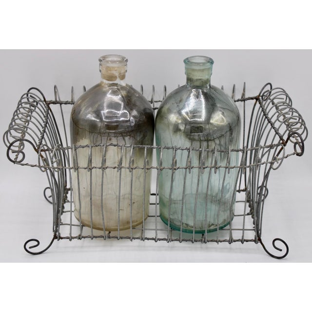 Very unique, vintage French footed metal wire jardiniere. (Antique Mercury glass jars pictured are available for sale,...