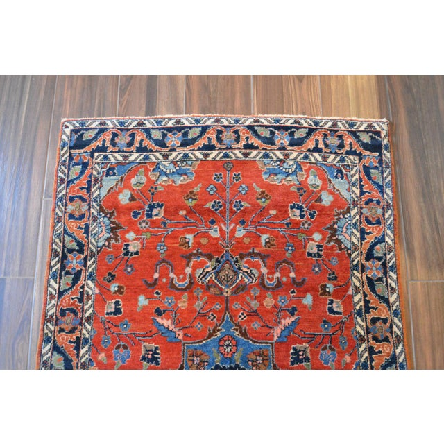 Offered is a top quality, vintage Persian Lilihan area rug featuring a small central medallion pattern with whimsical...