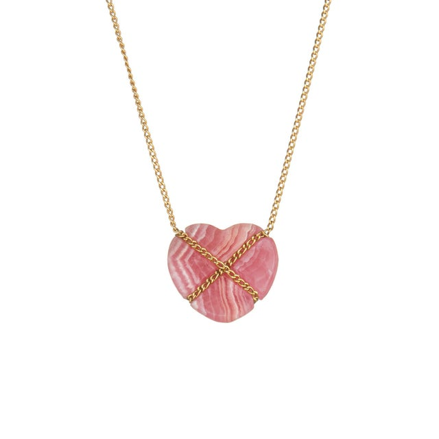 Elegant and finely detailed vintage Tiffany & Co rhodochrosite Cross My Heart necklace, crafted in 18 karat yellow gold....